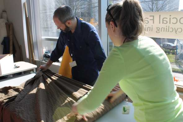 Workers Cutting Fabric