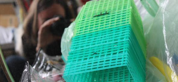 Ruby's studio was awash with millions of bits of recognizable plastic, like these little tomato baskets.