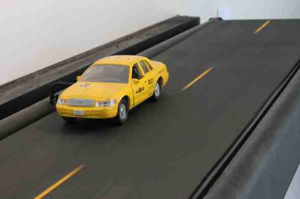 'Road to Nowhere,' by Ian Treasure, is made of a toy taxi cab, an exercise treadmill, and the motor from a copy machine.