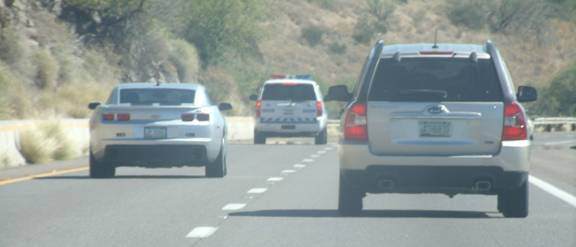 Trash Blog SUV on right.  Highway Patrol escort in front.  Unfortunately, the Holy Family had to be left behind in Phoenix to make some much needed room inside the Trash Blog SUV.  All the same, we would all like to believe that this couple will be well protected by those on both the secular and spiritual planes during all of their journeys.