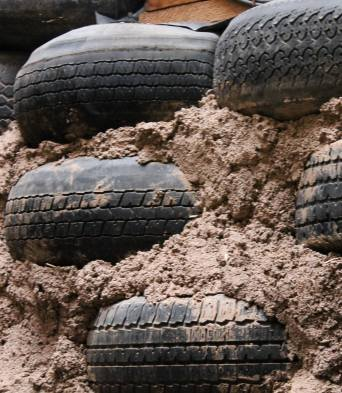 Dirt is pounded into the center of these tires with sledgehammers; the resulting wall is very strong.