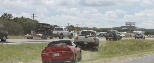 Now watch the cars that used to be in front of us preforming the same Texas trick. Notice in particular the large, white Texas Edition Ford F750.