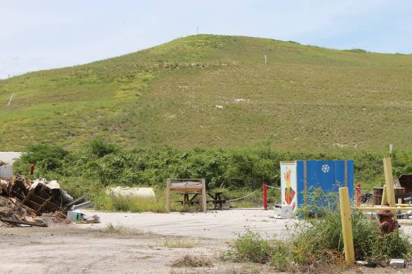 This grassy knoll, the Stock Island Landfill, is the real highest point in Key West.