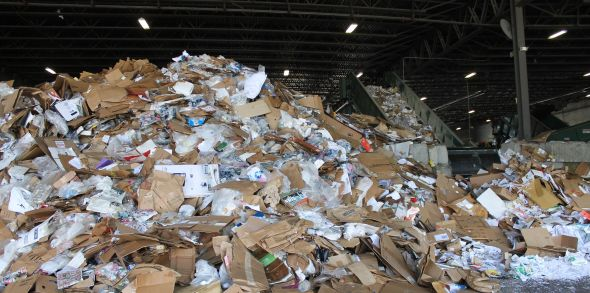 A pile of commingled recyclables. We have created elaborate, million-dollar recycling facilities to sort the various materials piled here, even though, with a little extra care, they could been kept separate before they even got here.
