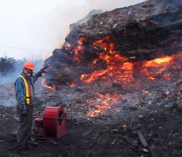 Landfill fire. Good thing that guy is wearing a mask...